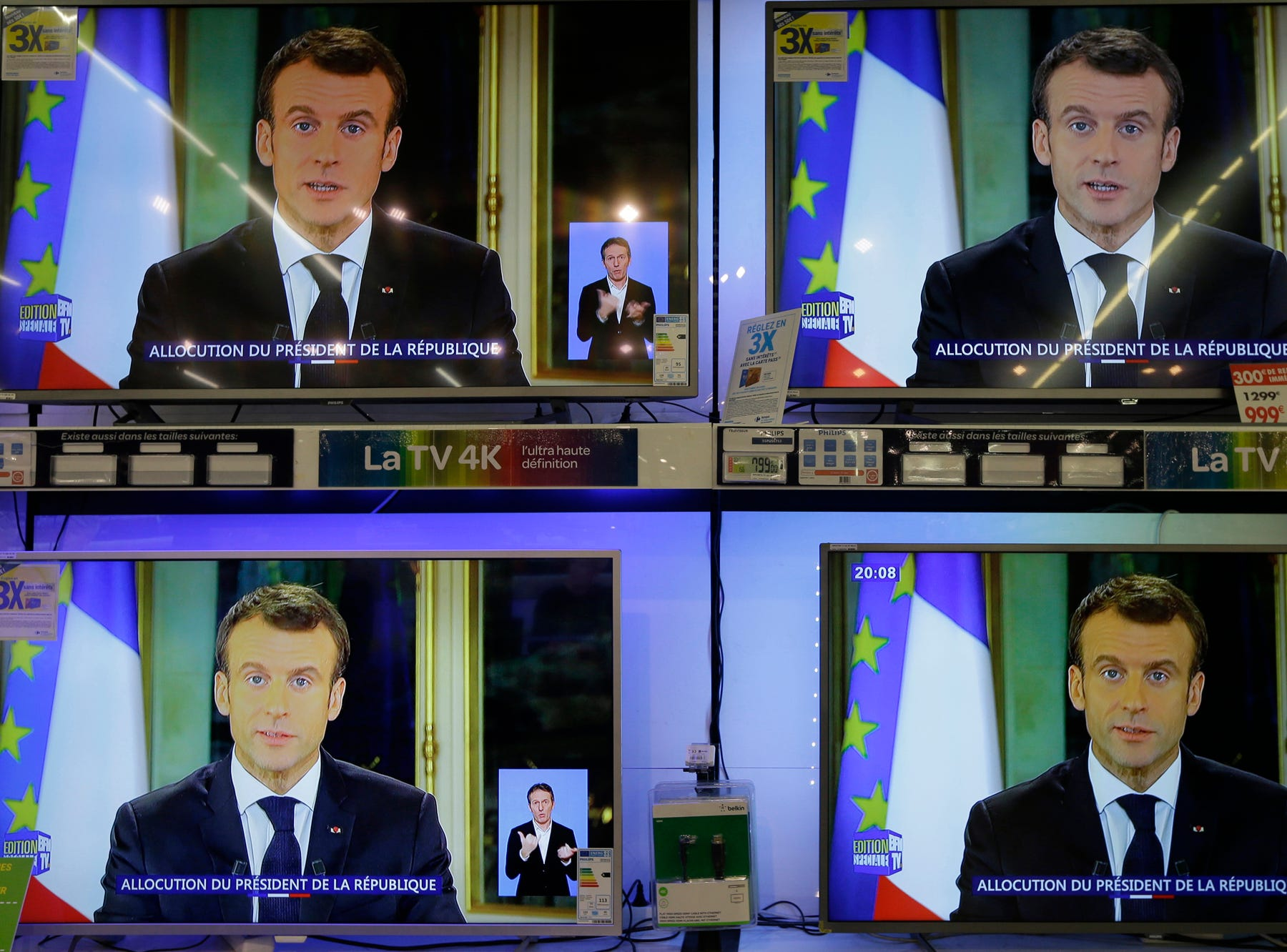 TV screens show French President Emmanuel during a televised address to the nation, at an electrical appliance store in Marseille, southern France, Monday, Dec. 10, 2018. President Emmanuel Macron has acknowledged he's partially responsible for the anger that has fueled weeks of protests in France, an unusual admission for the leader elected last year. (AP Photo/Claude Paris)