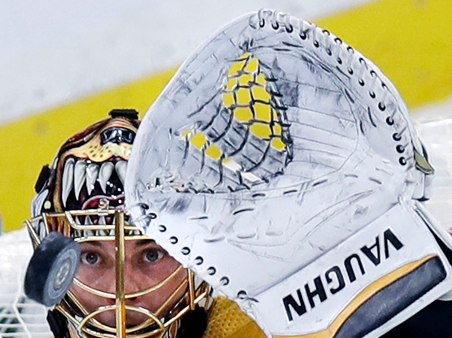 Boston Bruins goaltender Tuukka Rask eyes the puck on a save during the third period of an hockey game against the Arizona Coyotes in Boston, Tuesday, Dec. 11, 2018. (AP Photo/Charles Krupa)