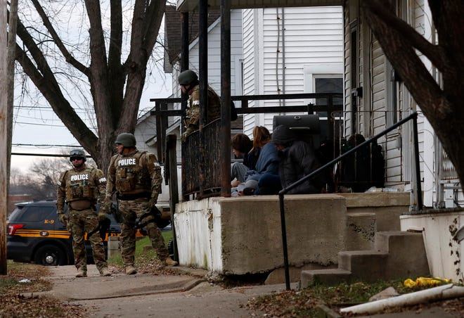 "Lancaster Police Special Response Team members stand in front of 818 West Fifth Avenue Thursday, Dec. 13, 2018, in Lancaster. LPD SRT members and Fairfield-Hocking-Athens Major Crimes Unit detective served a search warrant at the house Thursday. MCU Cmd. Dennis Lowe said officers found a ""large quantity of methamphetamine, suspected tar heroin, brown heroin, fentanyl and prescription medication"" in the house."
