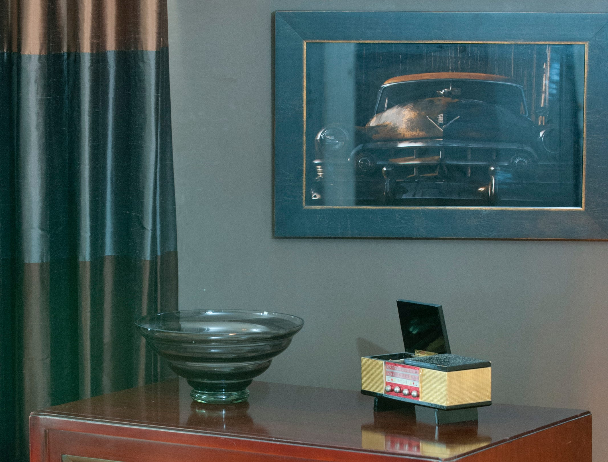 This vintage RCA console sits below a photograph of a 1950's Cadillac in the master bedroom.10 December 2018