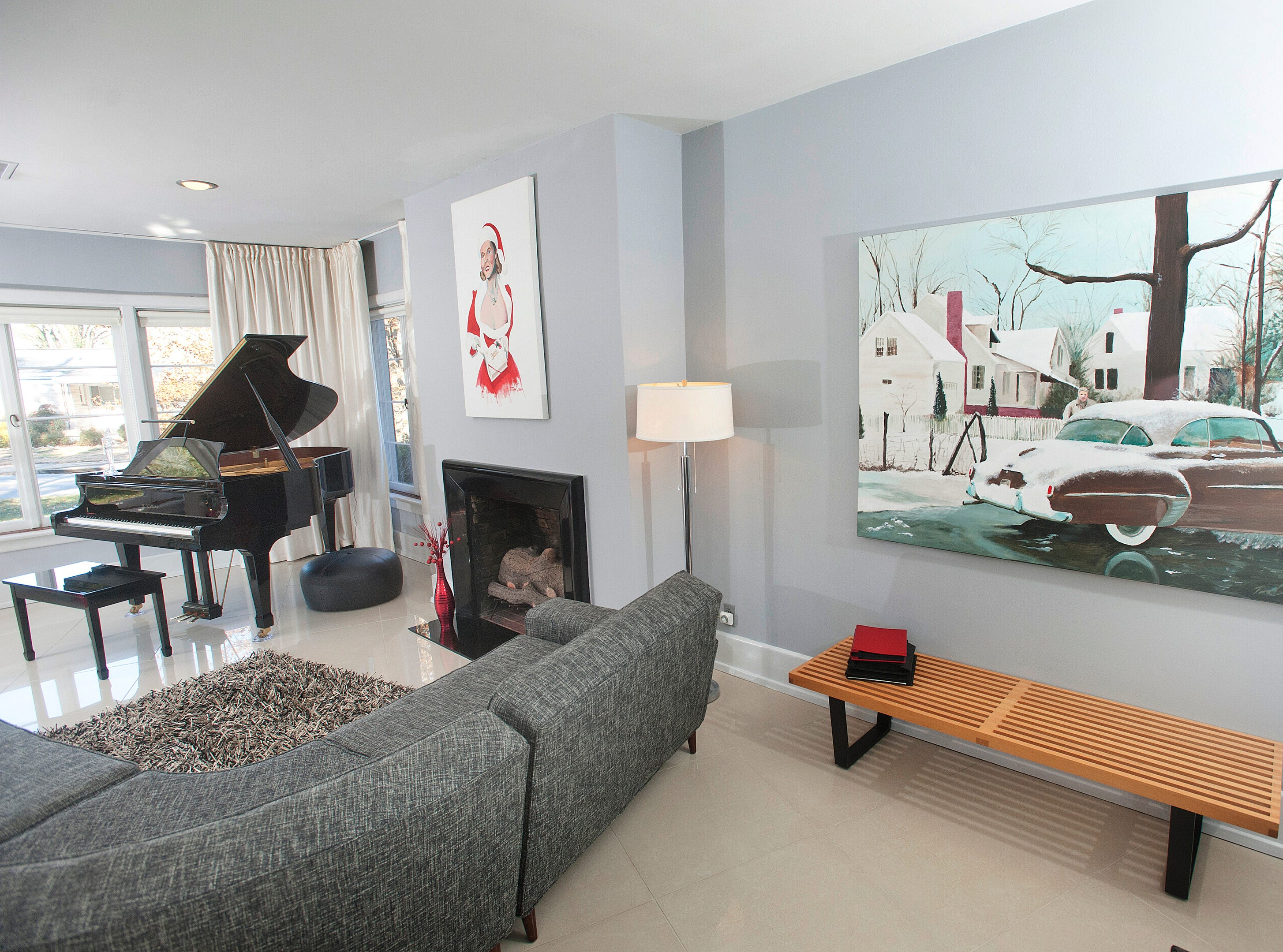 """The home's living room. At right, Cannady's painting called """"Federberg,"""" reproduced a scene of Cannady's dad caught in an old photograph.10 December 2018"""