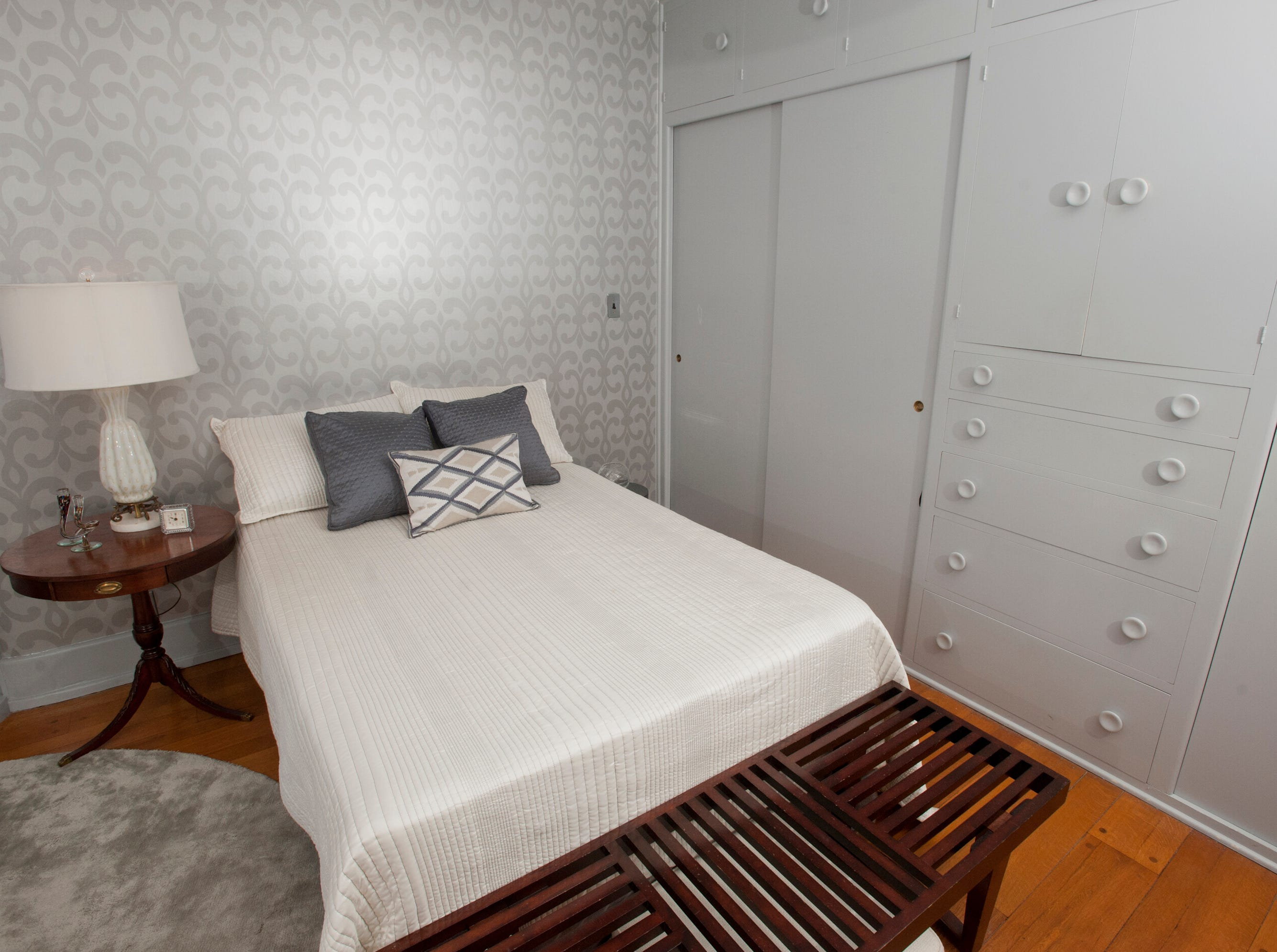 The home's guest bedroom features built-in closets and drawers, at right.10 December 2018