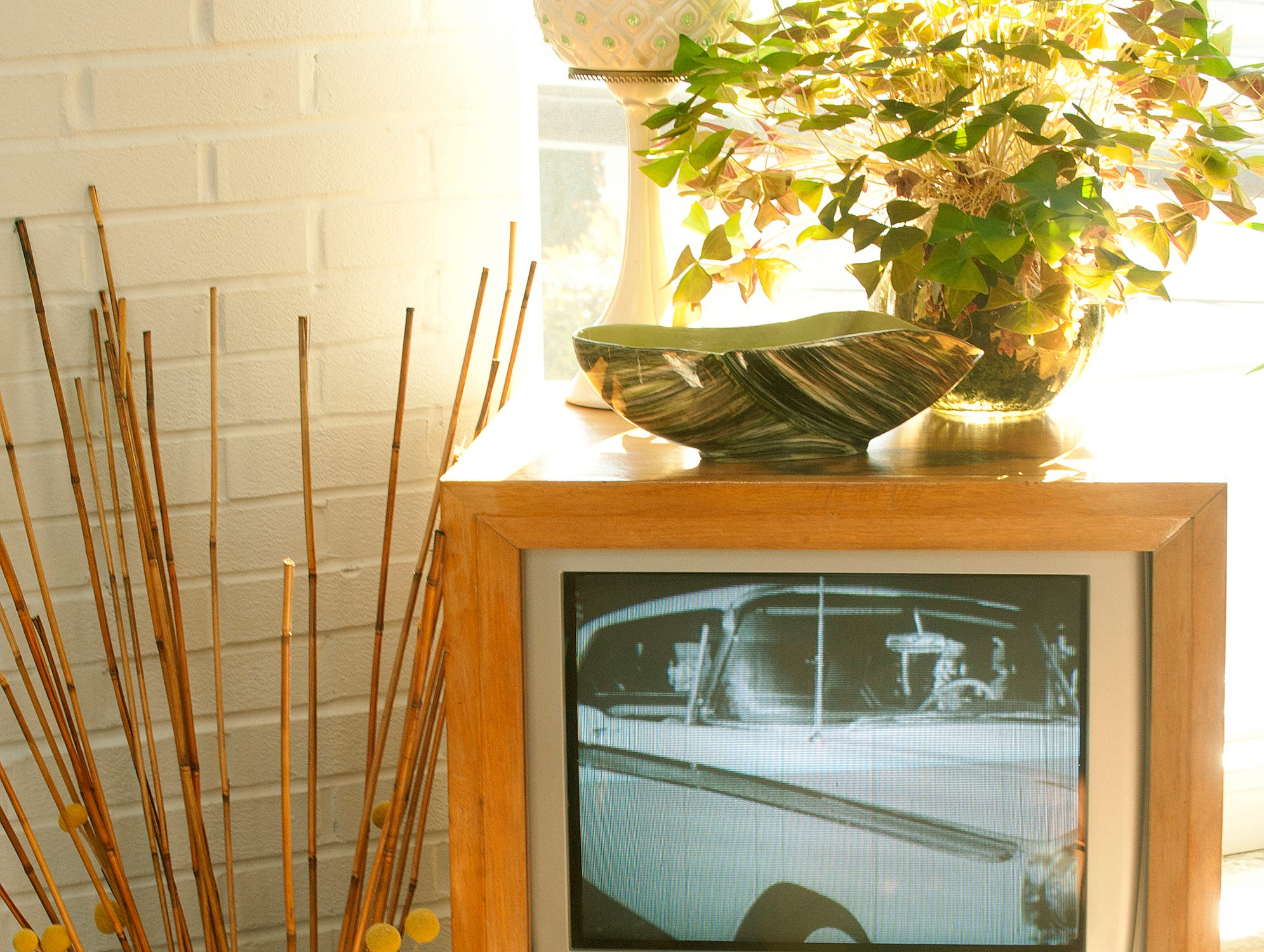 A contemporary cassette, digital video player and television have been fitted into this old television cabinet. The television was playing a loop of vintage ford commercials. 10 December 2018