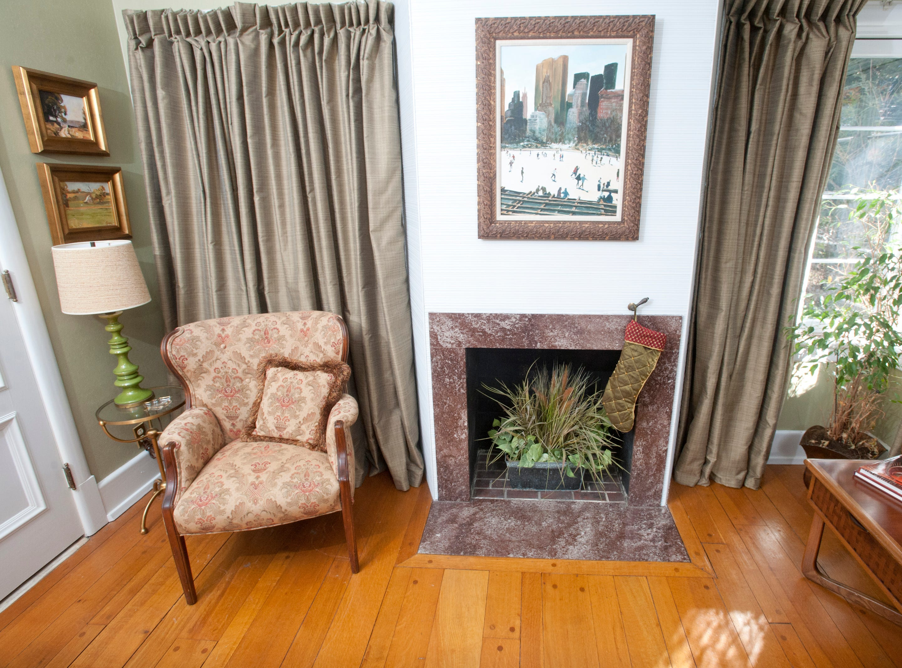 A fireplace and chair in the television room.10 December 2018