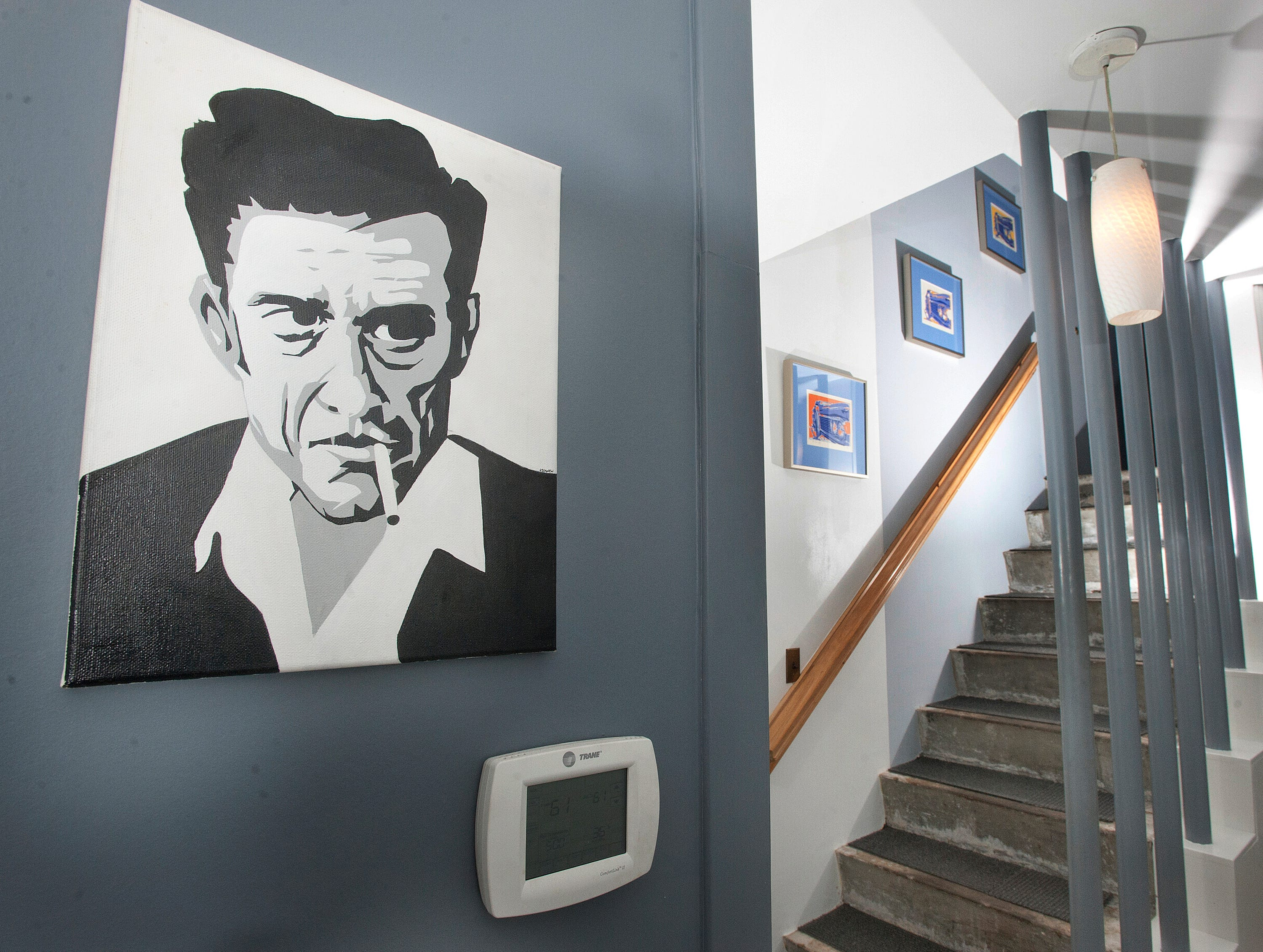This portrait of Johnny Cash, bought by Cannady at an art fair, hangs at the base of the stairwell to the 2nd floor.10 December 2018