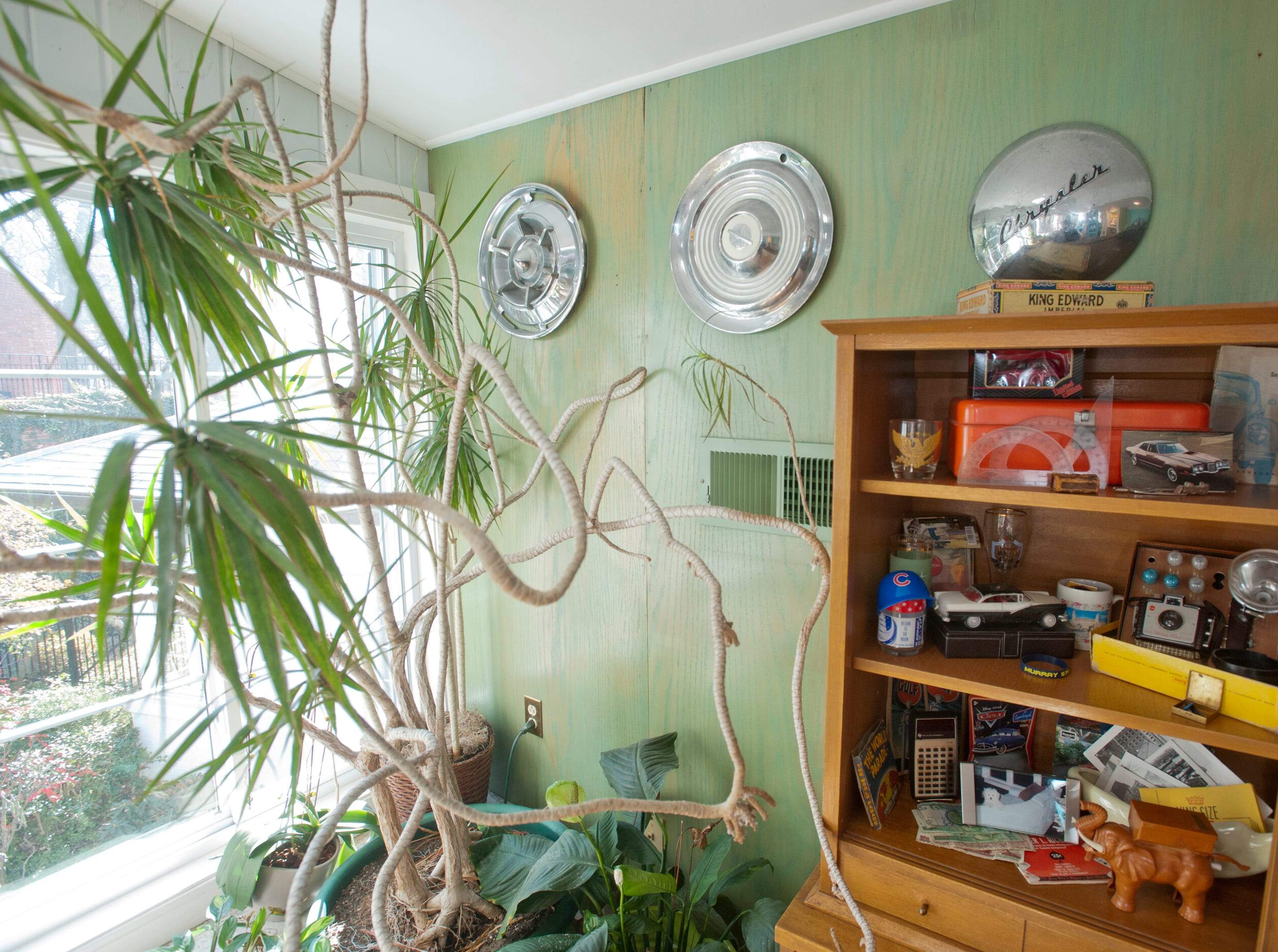 The sun room off the bar on the second floor. The wall is decorated with hubcaps and a cabinet of memorabilia including model cars and a Kodak Brownie camera set.10 December 2018