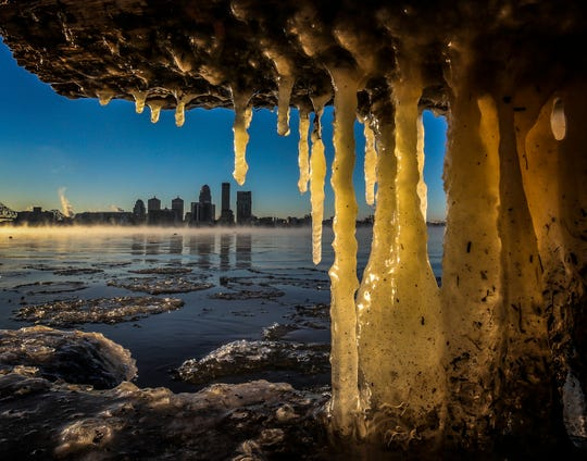 The morning sun gives a warm glow to ice formed a log along the Indiana side of the Ohio River.  Much of the east coast is dealing with below-normal temperatures, including the Louisville area with the mercury hovering around 0.January 2, 2018