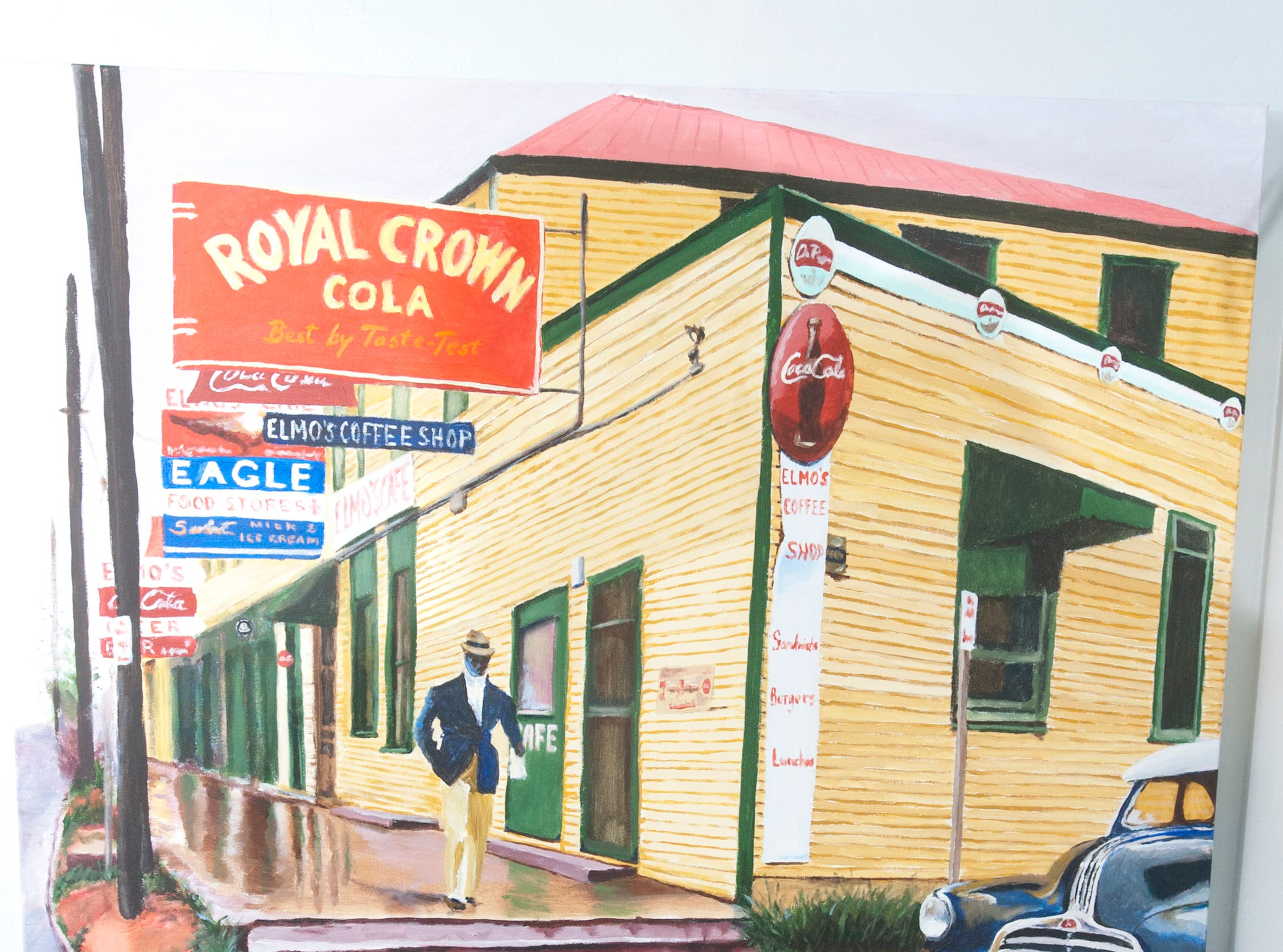 This Cannady painting of a man walking under a Royal Crown Cola sign hangs over a small side table with liquor bottles and and ice bucket in the Princess bar room on the second floor.10 December 2018