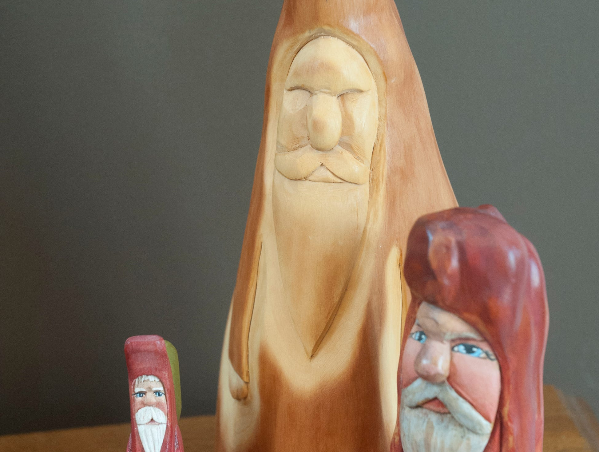 These cypress wood Santas made by Kentucky artist Joe Offerman help to decorate the Commonwealth Room. 10 December 2018