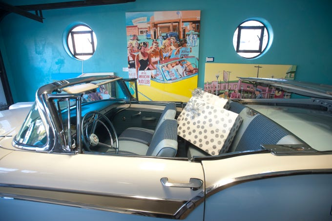 Christmas presents are in the back seat of this 1957 Ford Skyline in the home's garage. The room is filled with Cannady's auto-themed artwork and pieces are occasionally exchanged with those inside to keep the decor fresh.10 December 2018