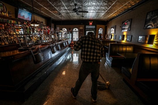 Rick Wessling mops the floor at Barret Bar.  Wessling began mopping the floor of the bar at age six when his father owned it.  He estimates that he's mopped it at least 18,000 times . December 12, 2018
