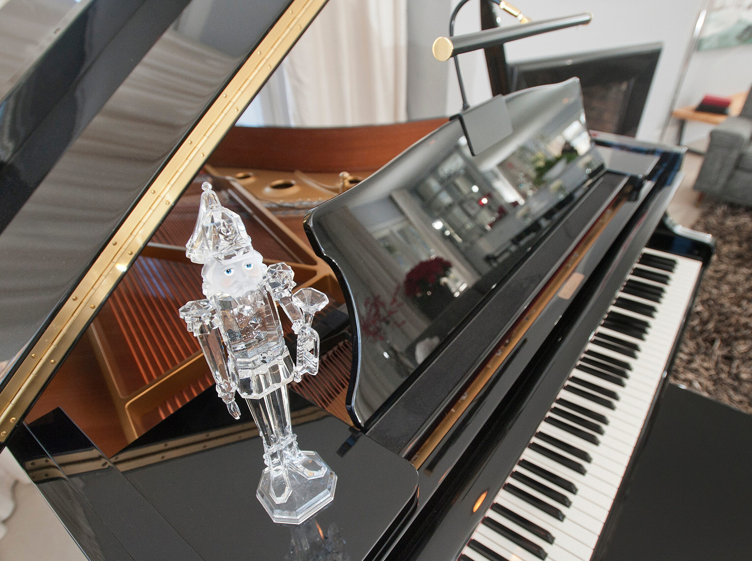 """This acrylic nutcracker called """"Mrs. Claws,"""" sits atop the grand piano in the home's living room.10 December 2018"""
