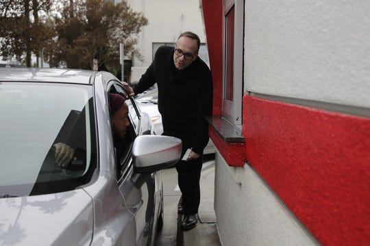Father Jim Sichko interacts with a customer at a California In-N-Out Burger after paying for the man's meal. Sec. 5, 2018