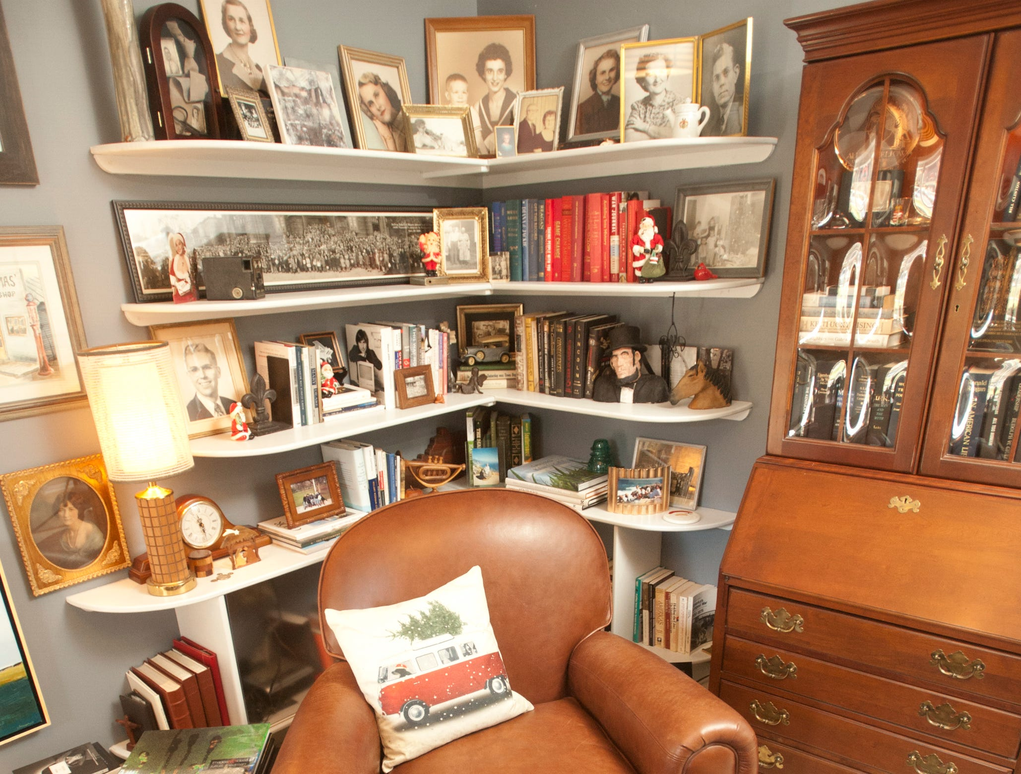 Portraits of family members and friends of both Casebier  and Cannady adorn the shelves of the Commenwealth Room.10 December 2018