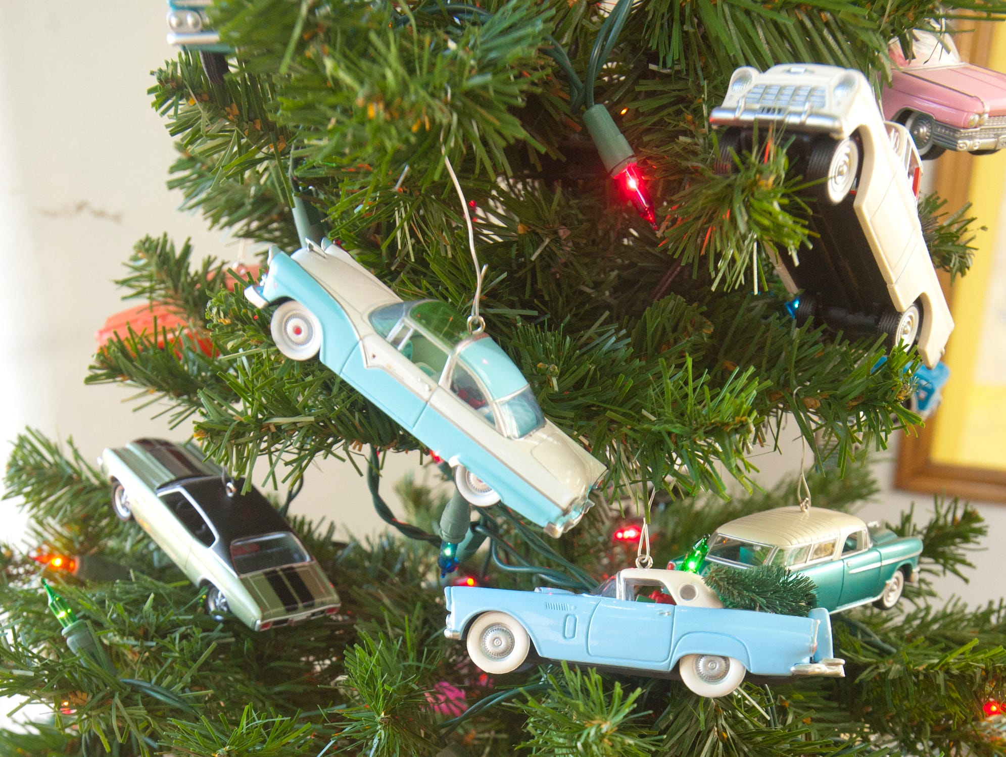 """Automobile ornaments adorn the Christmas tree in the """"Princess"""" bar.10 December 2018"""