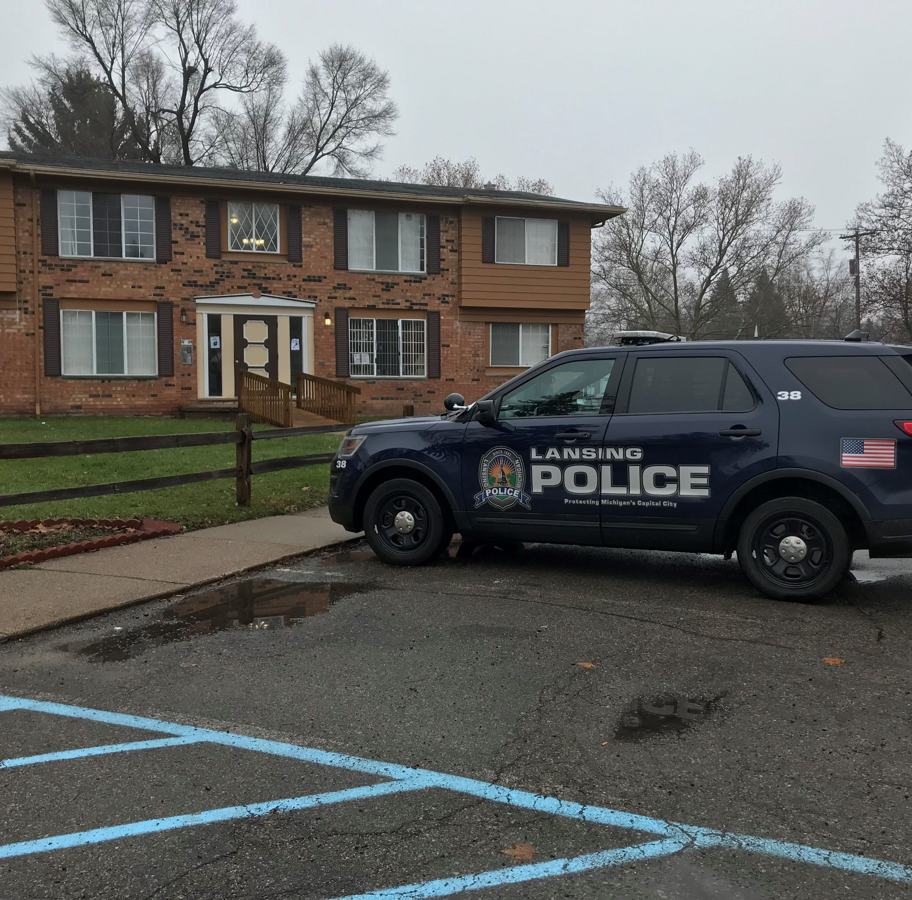 Police investigating body found in Lansing apartment complex as a homicide