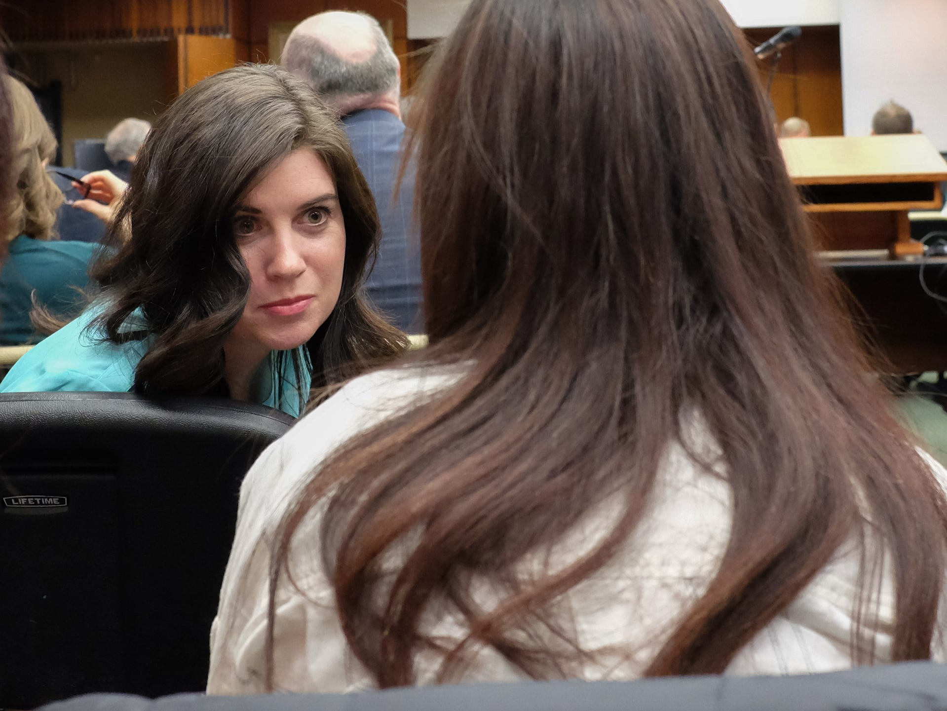 Larissa Boyce, Nassar survivor, talks with another survivor Kaylee Lorincz at the MSU Board of Trustees meeting Friday, Dec. 14, 2018.