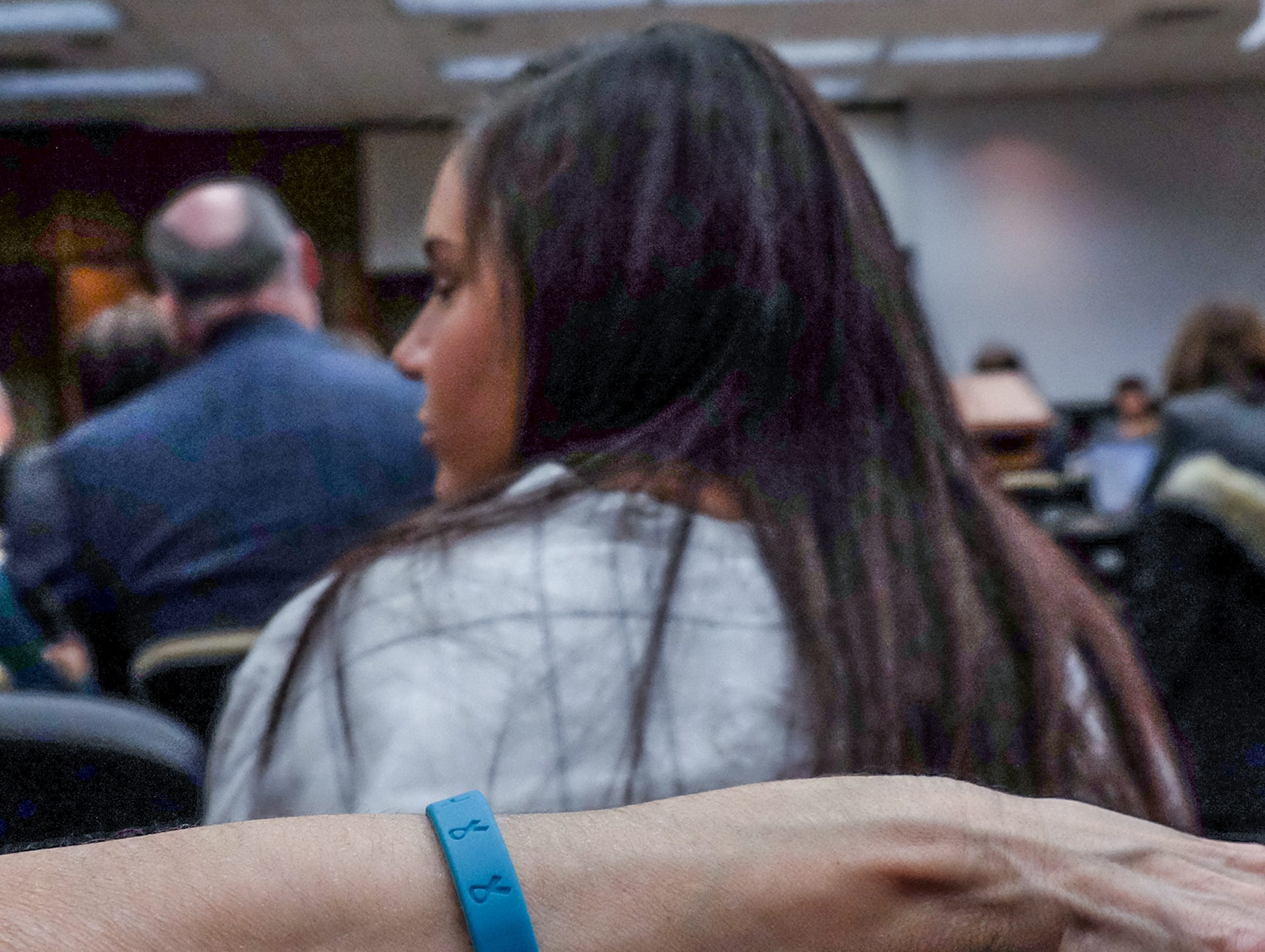 Lisa Lorincz wears a teal colored survivors bracelet  to support her daughter Kaylee who is a survivor of Larry Nassar at a MSU Board of Trustees meeting Friday, Dec. 14, 2018.