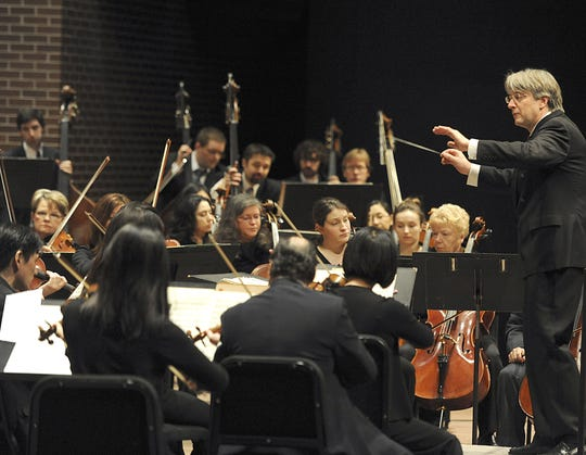 Lansing Symphony Orchestra music director and conductor Timothy Muffitt leads musicians at a Young People's Concert at the Wharton Center in this file photo. The symphony is one of the local arts groups that could benefit from a new performing arts center being discussed for downtown Lansing.