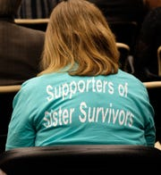 Supporters of the survivors of the Larry Nassar scandal at MSU wear t-shirts at the MSU Board of Trustees meeting Friday, Dec. 14, 2018. Several of them spoke expressing their disgust with the Board cancelling the Healing Assistance Fund.