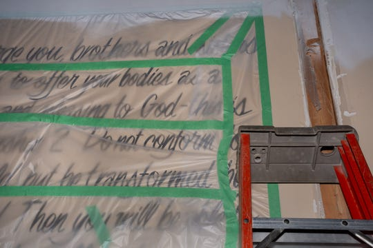 Bible verses are written on walls at The Outreach, a property at 601 N. Larch St. in Lansing. The building is being renovated by the City Rescue Mission of Lansing and will serve as a 24-7 drop-in center for the homeless.