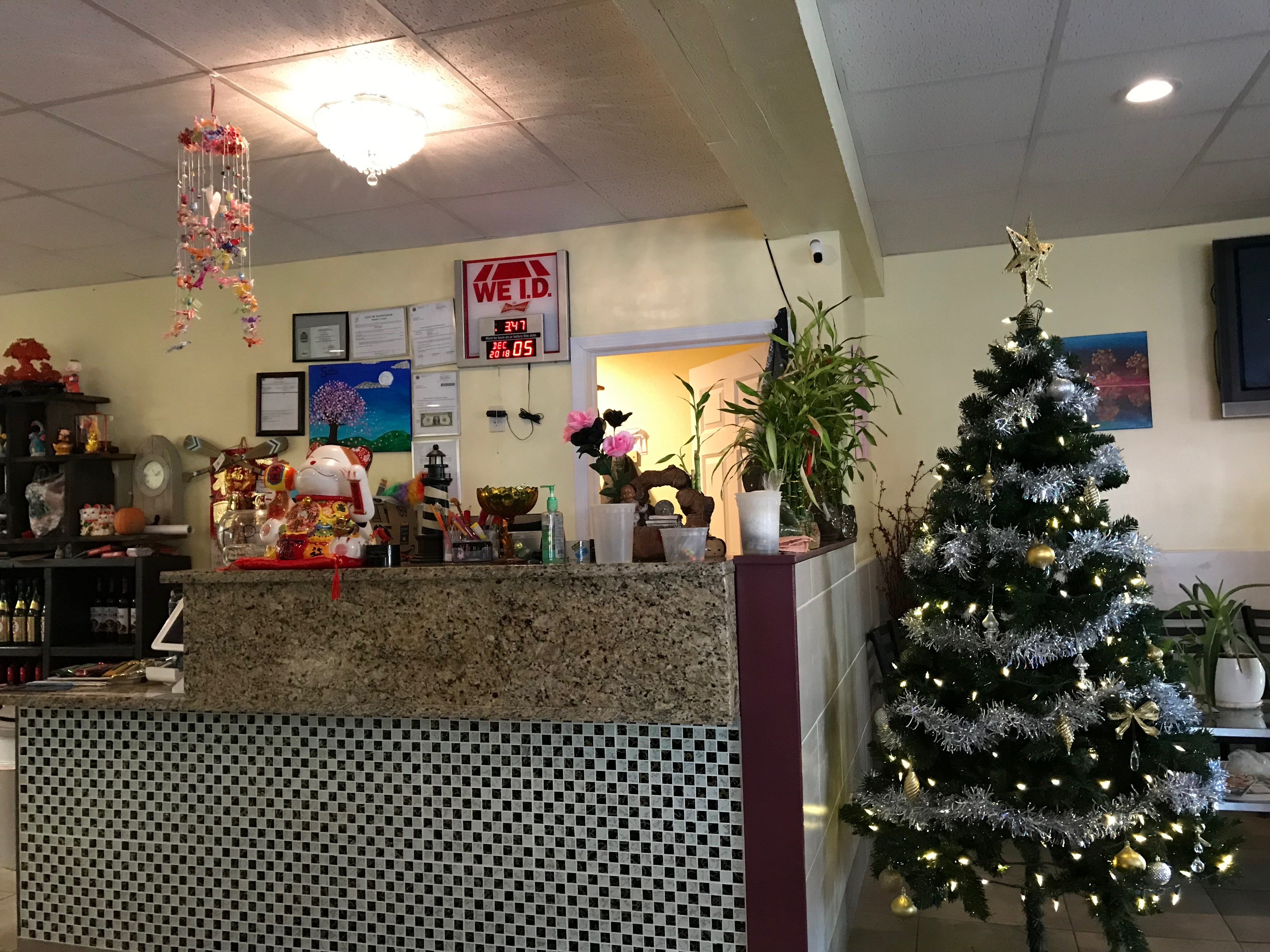 The front desk is decorated for Christmas at Sakura Sushi & Thai.