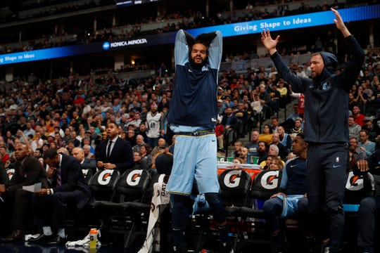 Memphis Grizzlies center Joakim Noah (55) and Memphis Grizzlies forward Chandler Parsons (25) react to a call in the second half of an NBA basketball game Monday, Dec. 10, 2018, in Denver. The Nuggets won 105-99. (AP Photo/David Zalubowski)