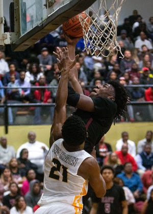 East Memphis Mustangs, James Wiseman (32), shoots over Whitehaven Tigers, Devin Owens (21), during the first half of high school basketball game, Thursday, Dec. 13, 2018.