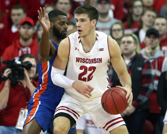 Dec 13, 2018; Madison, WI, USA; (Editors Notes: Caption Correction) Wisconsin Badgers forward Ethan Happ (22) works the ball against Savannah State Tigers guard Adam Saeed (left) at the Kohl Center. Mandatory Credit: Mary Langenfeld-USA TODAY Sports