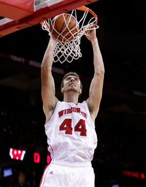 Wisconsin's Frank Kaminsky dunks against North Dakota during the second half of an NCAA college basketball game Tuesday, Nov. 19, 2013, in Madison, Wis. Kaminsky set school single-game record 43 points in Wisconsin's 103-85 win.