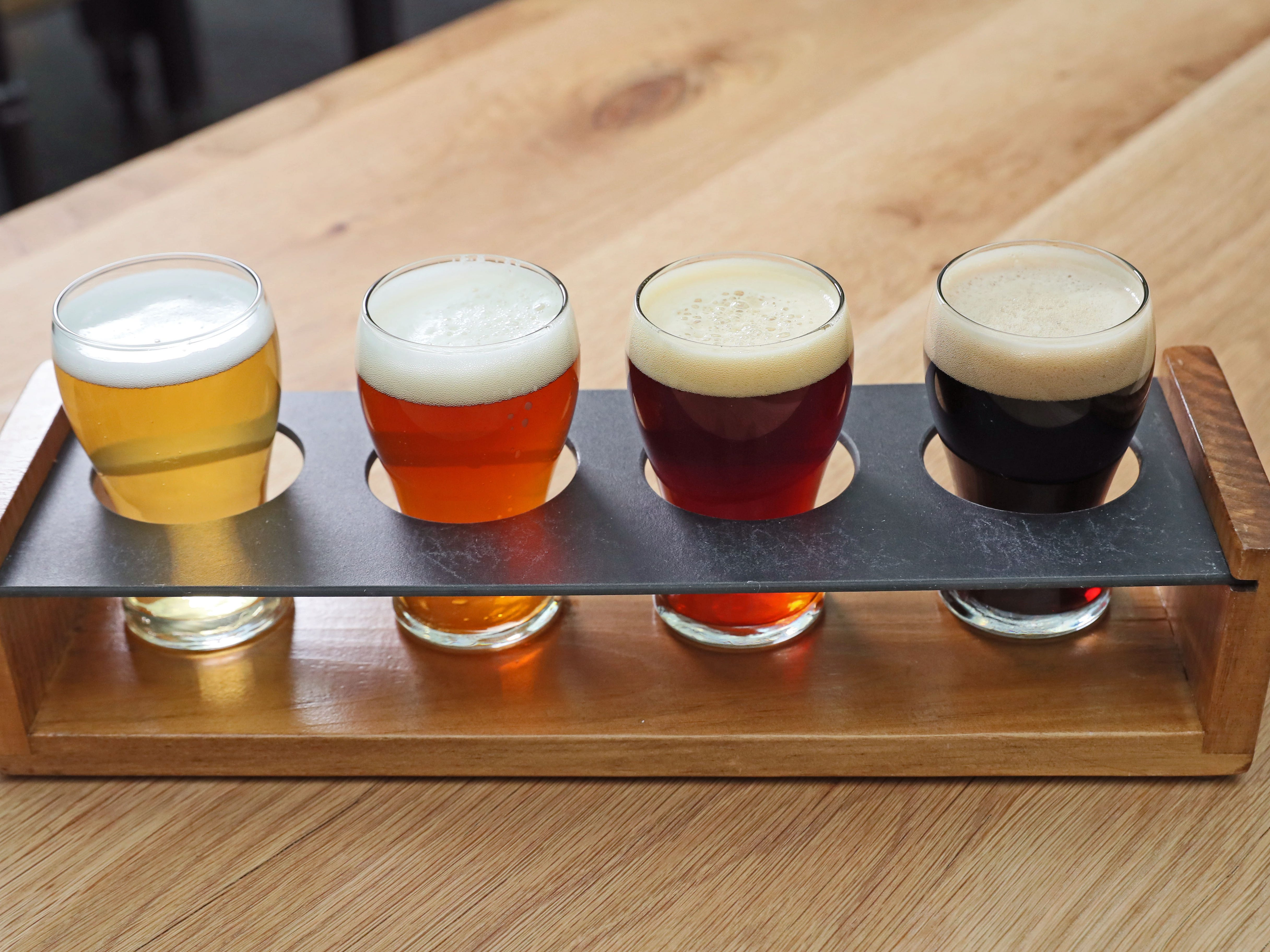A beer flight is ready for customers in December 2018 at Glass + Griddle.