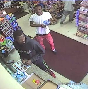 The suspect of an armed robbery in New Berlin on July 31 is pictured here, wearing a black sweatshirt and red shoes.