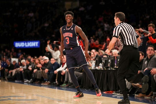 Dec 12, 2016; New York, NY, USA;  Auburn Tigers forward Danjel Purifoy (3) reacts after a three point basket against the Boston College Eagles during the second half of the first game of the Under Armour Reunion at Madison Square Garden. Boston College won, 72-71.  Mandatory Credit: Vincent Carchietta-USA TODAY Sports