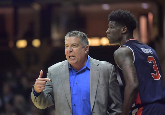 Jan 4, 2017; Nashville, TN, USA; Auburn Tigers head coach Bruce Pearl and forward Danjel Purifoy (3) react in the first half against the Vanderbilt Commodores at Memorial Gymnasium. Mandatory Credit: Jim Brown-USA TODAY Sports
