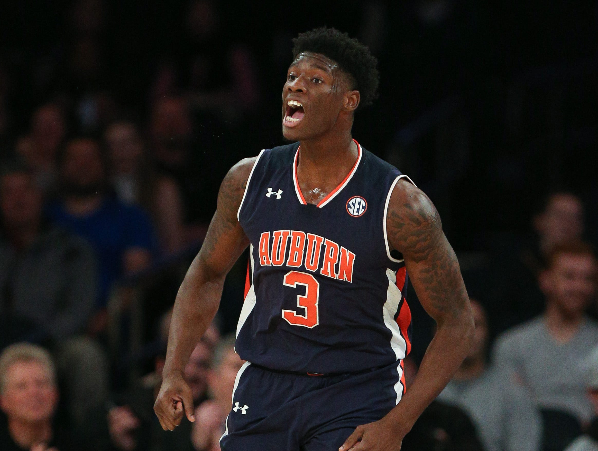 Dec 12, 2016; New York, NY, USA;  Auburn Tigers forward Danjel Purifoy (3) celebrates after a basket against the Boston College Eagles during the first half of the first game of the Under Armour Reunion at Madison Square Garden. Mandatory Credit: Vincent Carchietta-USA TODAY Sports