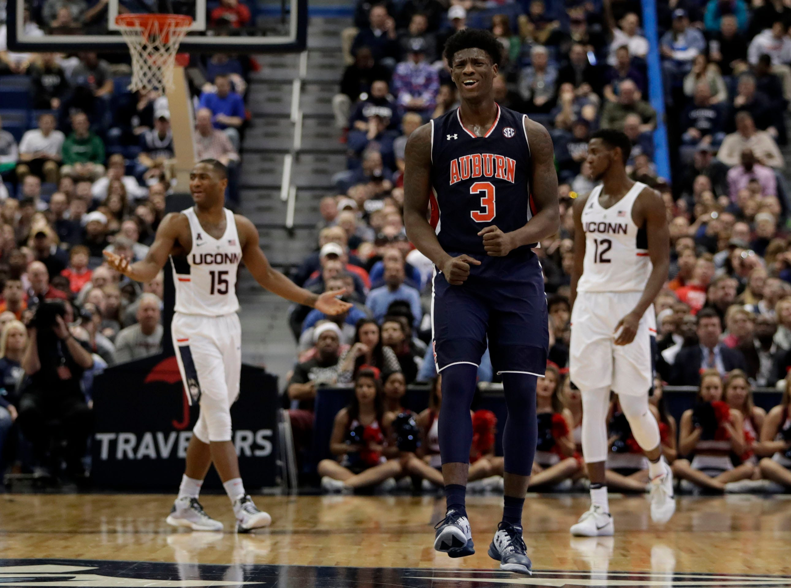 Dec 23, 2016; Hartford, CT, USA; Auburn Tigers forward Danjel Purifoy (3) reacts to a play against Connecticut Huskies guard Rodney Purvis (15) in the second half at XL Center. Auburn defeated UConn in overtime 70-67. Mandatory Credit: David Butler II-USA TODAY Sports