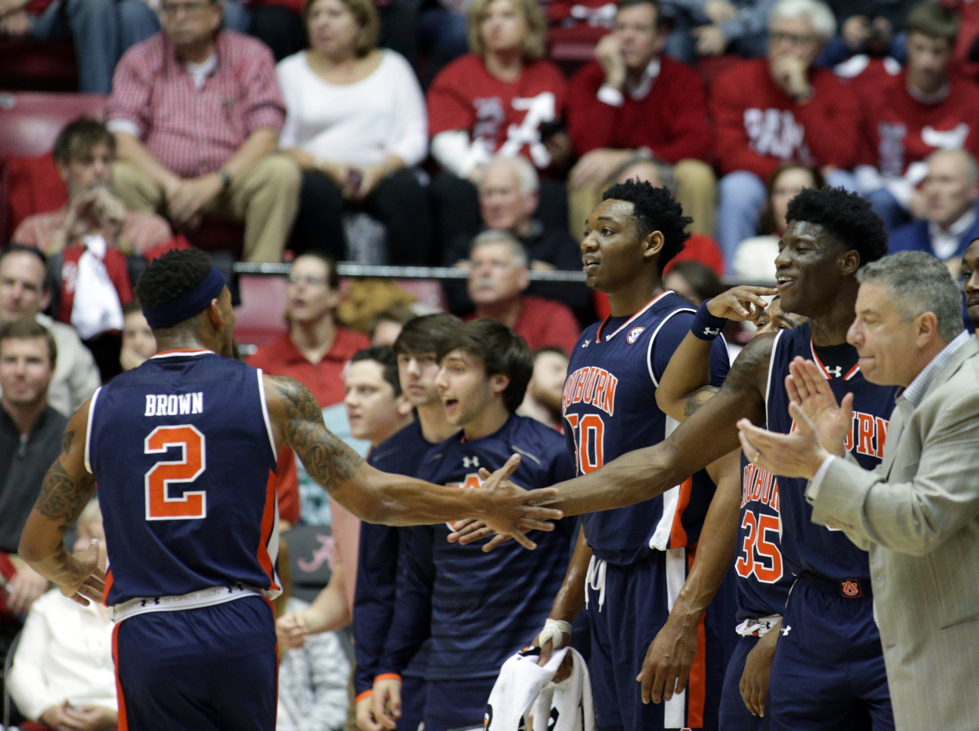 Feb 4, 2017; Tuscaloosa, AL, USA; Auburn Tigers guard Bryce Brown (2) celebrates with Auburn Tigers forward Danjel Purifoy (3) during the second half against the Alabama Crimson Tide at Coleman Coliseum. The Tigers defeated the Tide 82-77.  Mandatory Credit: Marvin Gentry-USA TODAY Sports