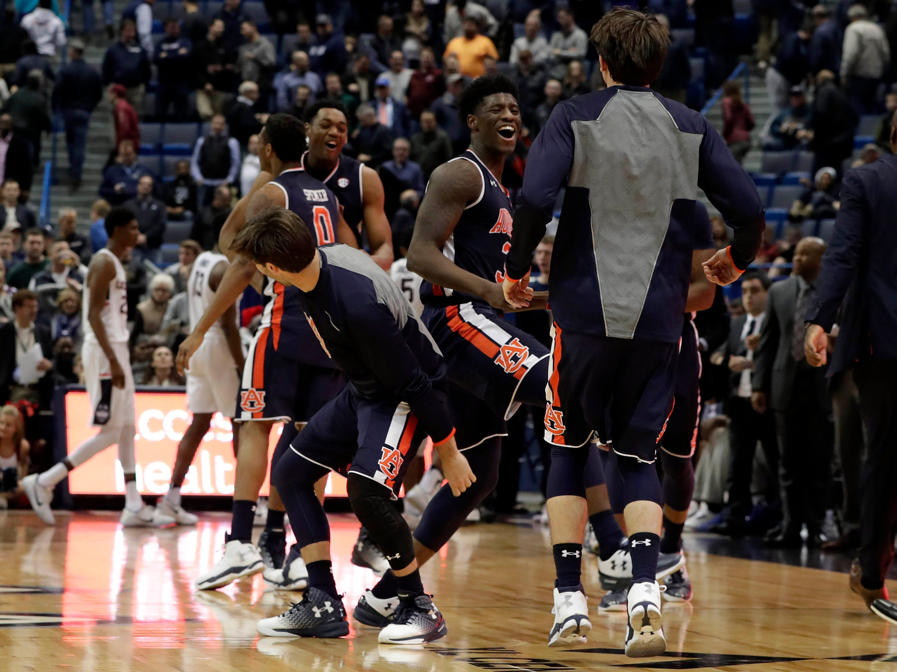 Dec 23, 2016; Hartford, CT, USA; Auburn Tigers forward Danjel Purifoy (3) and his teammates celebrate their overtime win against the Connecticut Huskies at XL Center. Auburn defeated UConn in overtime 70-67. Mandatory Credit: David Butler II-USA TODAY Sports