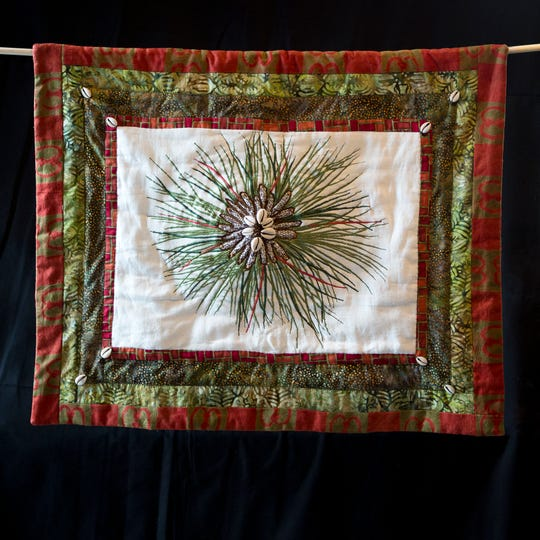 One of Lynda Tredway's quilts for Alabama. Each pine needle represents one lynching victim.