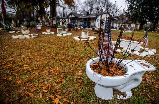 Wilbert Richardson's yard in Montgomery, Ala., is filled with found treasures on Friday December 14, 2018.