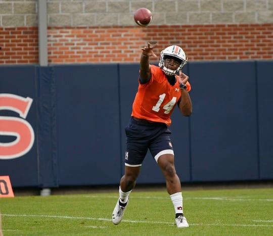 Auburn quarterback Malik Willis throws during practice.