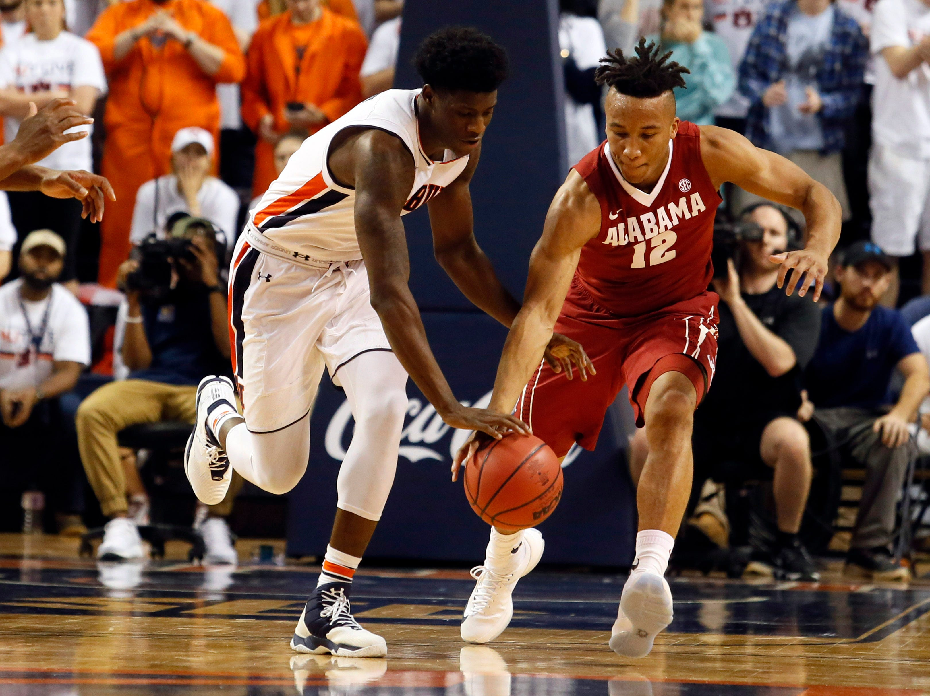 Jan 21, 2017; Auburn, AL, USA; Auburn Tigers forward Danjel Purifoy (3) and Alabama Crimson Tide guard Dazon Ingram (12) fight for the ball during the second half at Auburn Arena.  The Tigers beat the Tide 84-64. Mandatory Credit: John Reed-USA TODAY Sports