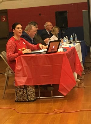 Muncie school board member Brittany Bales comments during a board meeting on Tuesday, Dec. 11, at Grissom Elementary School.