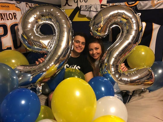 Jackson Taylor, left, and Caitlin Willard, are Stewarts Creek High School sweethearts. Taylor created an elaborate promposal using the Nashville Predators, and Willard said yes.