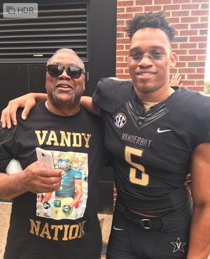 Vanderbilt senior safety LaDarius Wiley, right, poses with his father, Lincoln Sr., after a Commodores game. Lincoln Wiley Sr. died on Nov. 2.
