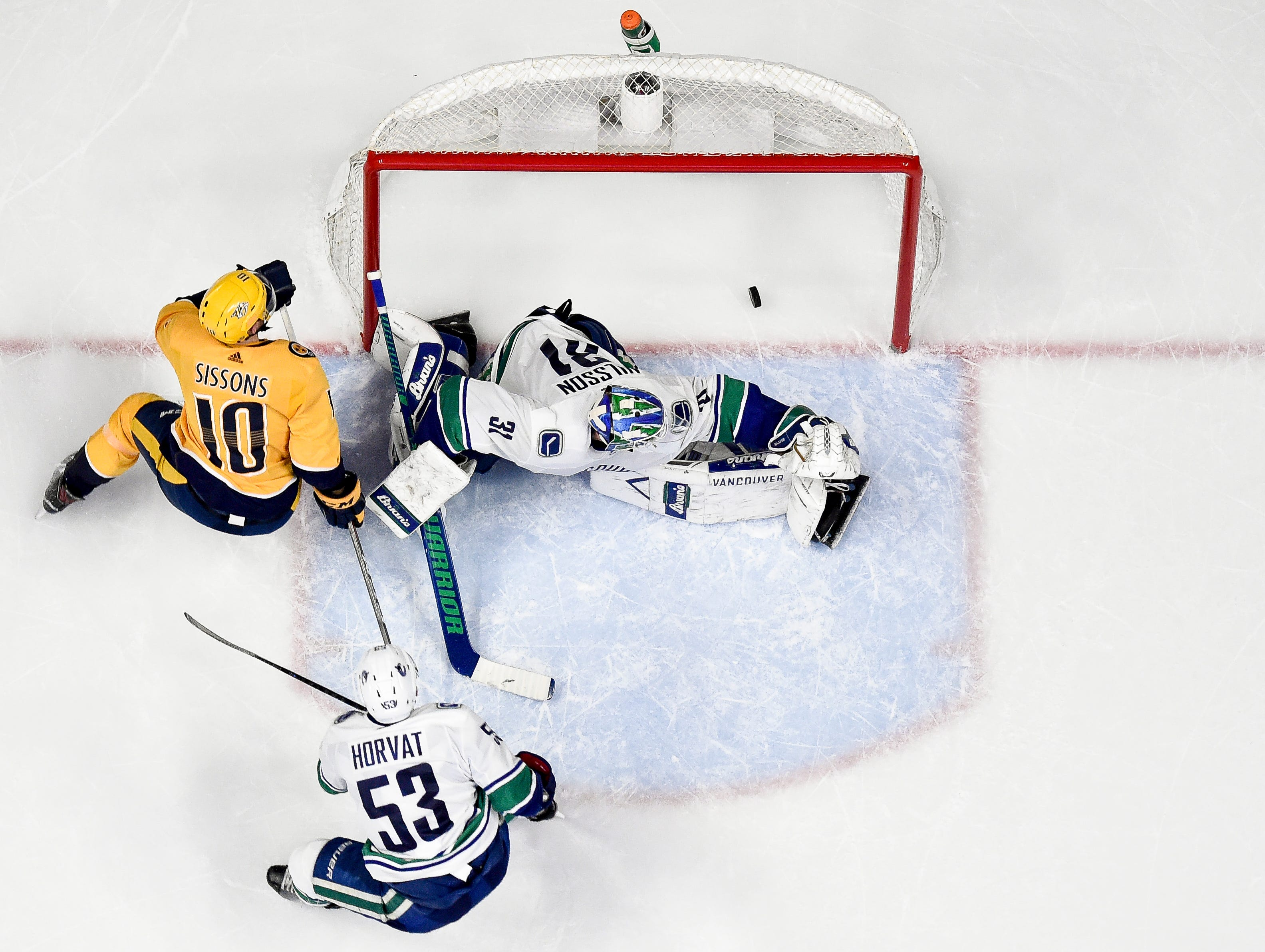 Nashville Predators center Colton Sissons (10) scores the game-winning goal past Vancouver Canucks goaltender Anders Nilsson (31) in overtime at Bridgestone Arena in Nashville, Tenn., Thursday, Dec. 13, 2018.