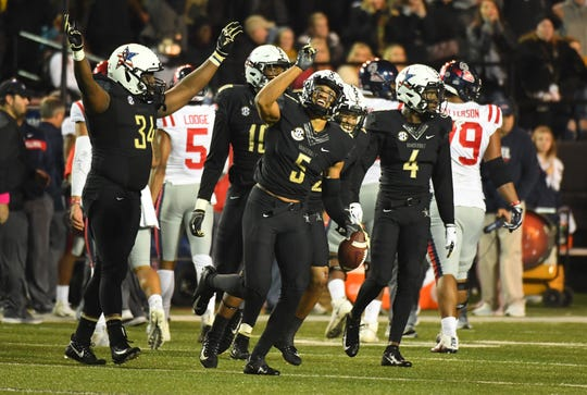 Vanderbilt safety LaDarius Wiley (5) point to the sky while celebrating his interception in an overtime win over Ole Miss on Nov. 17, 2018. Wiley's father died on Nov. 2.
