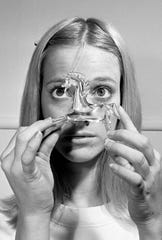 """Turning away from life to the company of her collection of glass animals, Laura Wingfield in """"The Glass Menagerie"""" has a sad and lost look. Sandra Locke, here Nov. 9, 1965, played this role in the Theater Nashville production of Tennessee Williams' masterpiece."""