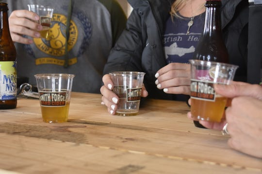 John and Trish Nelson taste beer from Delaware-based Dogfish Head Brewery while meeting with representatives of the company. They plan to offer Dogfish Head Brewery's beer at Flytes Brewhouse in Pleasant View.