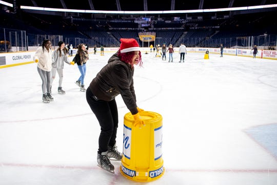 Andrea Robertson ice skates during the West Nashville Dream Center Holiday Party at Bridgestone Arena in Nashville, Tenn., Wednesday, Dec. 12, 2018.